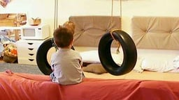Tire Swing Ups and Downs - Two swinging tires allow boys to determine their own level of challenge