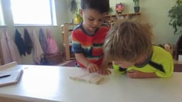 Math – Combining Sets - Two boys combine sets of five blocks - What they know and what they will eventually learn